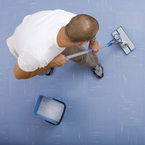 High angle view of man mopping floor